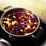 Plum-Ginger Pink Peppercorn syrup on the stovetop.  Smells so good!