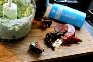 "Dates with smoked preserved jalapenos, goat cheese-watercress filling, and Creminelli's ""Campania"" salami"
