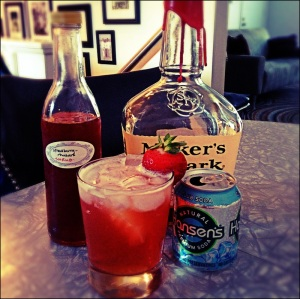 Mix strawberry-rhubarb shrub with equal parts bourbon and club soda for a pretty and pretty frickin' delicious cooler