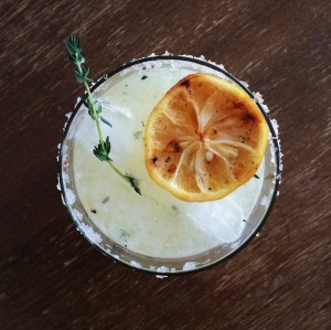 Sugar House Slingshot: silver rum, charred lemon, honey-thyme syrup, cardamom bitters, and salt.