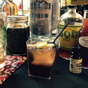 The Fall Fandango Silver rum, Applejack, stout beer syrup, cardamom & chocolate bitters, and apple Pok Pok